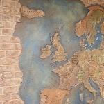 Reljef wall pano world map. Interior design